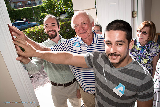 Local Young Adult's Moishe House Officially Opens with Mezuzah Hanging