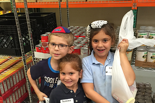 PJ Library® Brings Pajamas, Pizza and Mitzvot to the Food Pantry at JFS